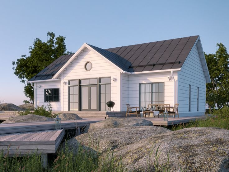 Honka Lounatuuli represents a New England style architecture that reminds of beach, sea and sand. Honka log homes.