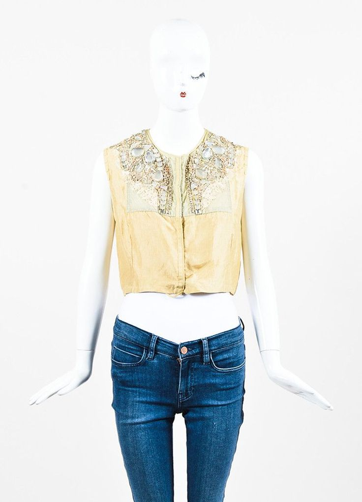 Beige silk vest is embellished with mesh, embroidered, swirling crystals, rhinestones, and beads. Snap and tie closure in front. Size: 40 Made in: Belgium Color: Beige Fabric Content: Silk Condition: