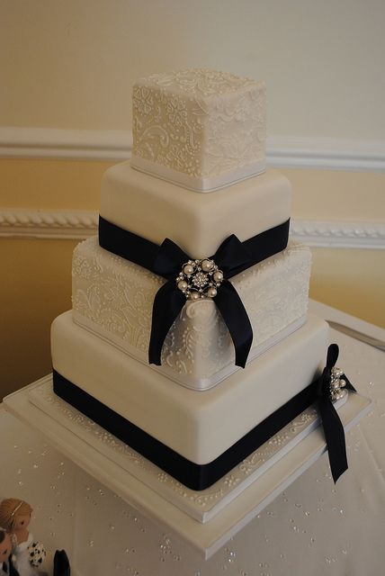 Think I would like a lace patterned cake to go with my lacey dress!    Navy and lace wedding cake by Bath Baby Cakes, via Flickr