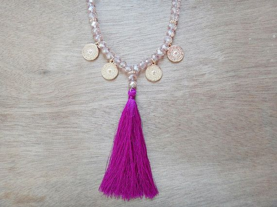 Tassel & Charms Necklace  Handmade long beaded necklace with pink crystal stones on silk cord adorned with gold plated cast pendants and fuchsia-purple
