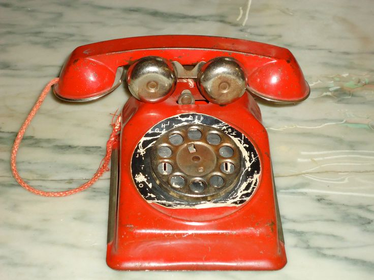 vintage 1950s metal red play telephone tin toy by GypsyWagonDesign on Etsy https://www.etsy.com/listing/94131221/vintage-1950s-metal-red-play-telephone
