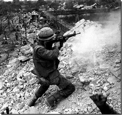 US marine firing his M16 during the battle of Hue, February 1968