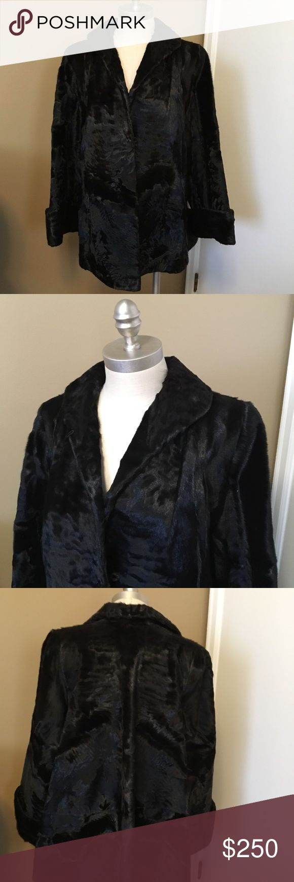 """vintage black fur swing coat considering myself somewhat of a fur connoisseur, i have absolutely no idea what kind this coat is made of. the fur is super soft and it glistens like a liquid. the pelts, though vintage, are not dry and the coat is heavy and warm and well-made. so, i ask you, do you have to know how to write code to use a smartphone? no. so, indulge and enjoy this magnificent piece of sartorial wizardry. (fur, 22"""" across, 27"""" long, 22"""" sleeves, 30"""" sweep) Vintage Jackets & Coats"""