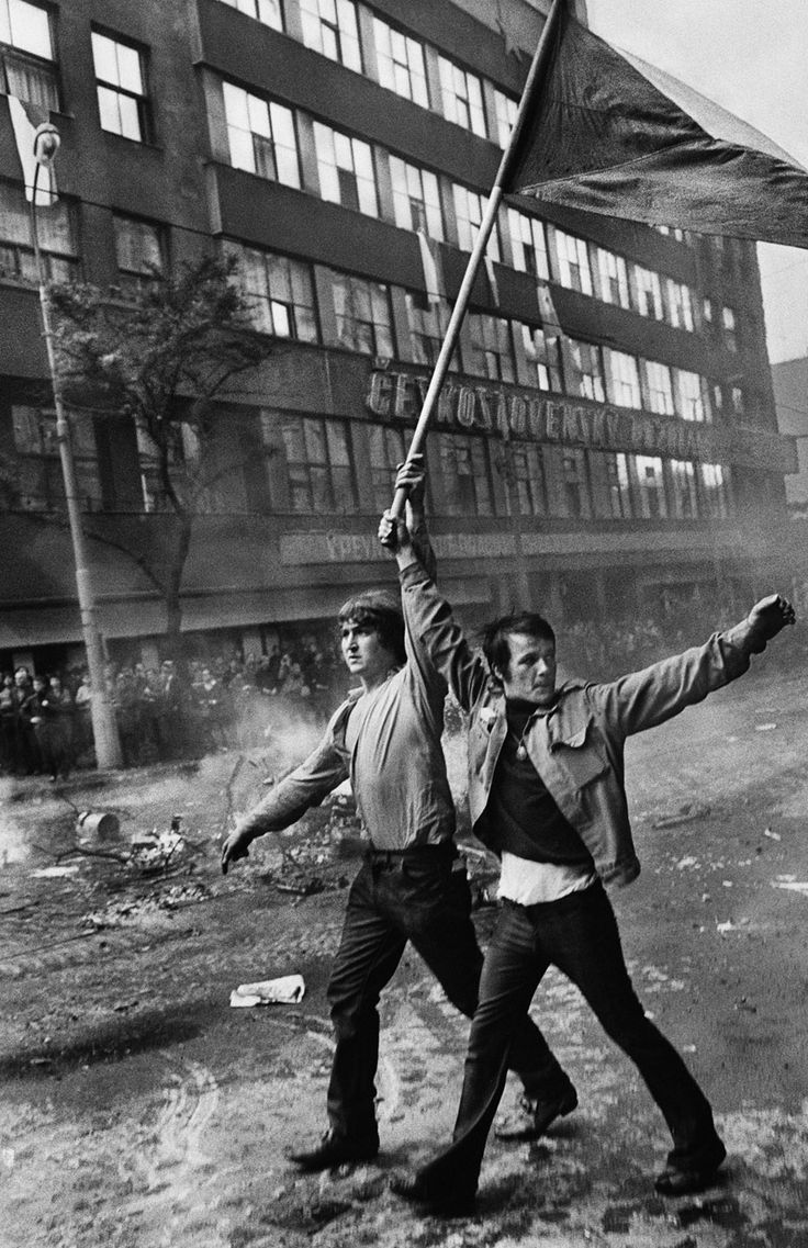 (Two Czech citizens with flag) 1968; photo by Josef Koudelka