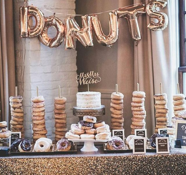 Fun donut bar at a wedding is amazing.