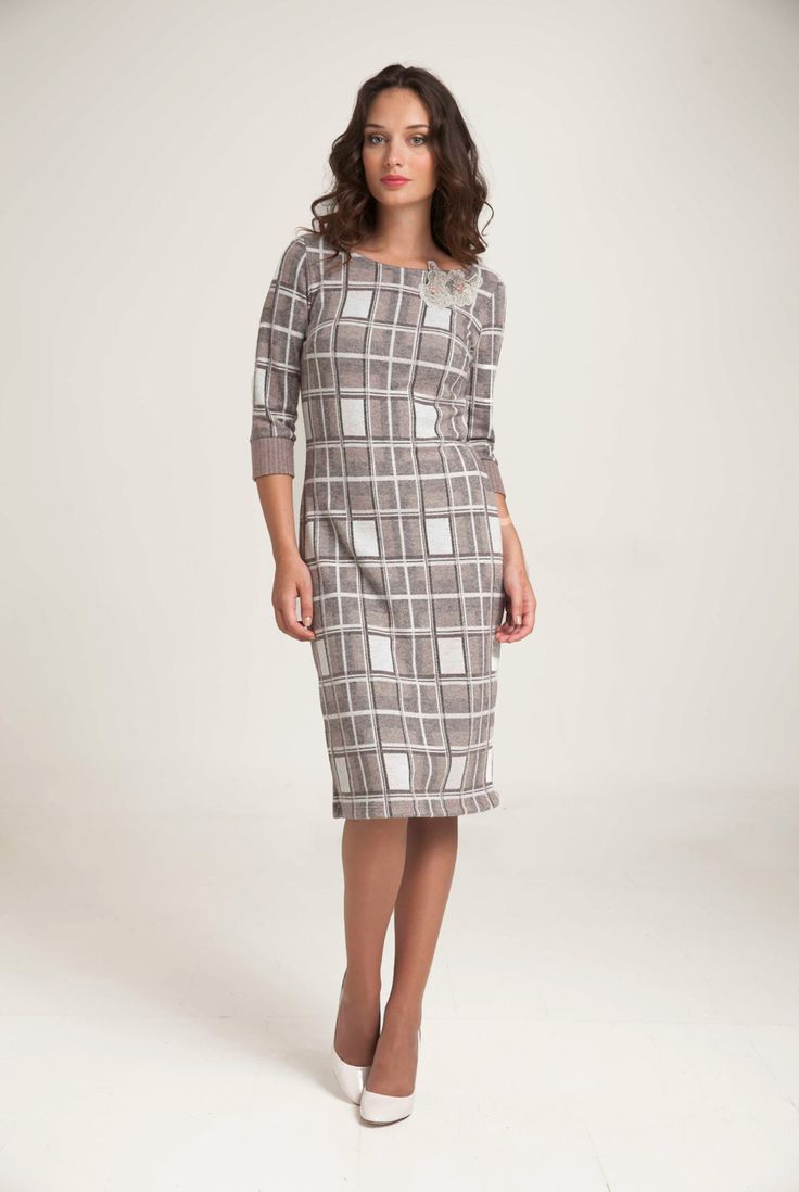 "Knitted jacquard dress in a check design. ""Boat"" neck and three quarter sleeves. Fine yarn pattern at neckline with embroidered beads sewn by hand. Straight line Knee length. Combine with pastel color cardigan or herringbone open cardigan for an office look. http://www.alexanderjacob.com/en/dresses/174-knitted-check-dress.html"