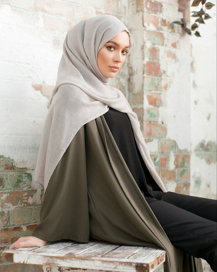INAYAH | A staple statement kimono in a classic khaki, encapsulating an effortless vibrant aesthetic. Khaki Georgette Kimono Black Crepe Top Black Straight Leg Trousers Feather Grey Modal Hijab www.inayah.co