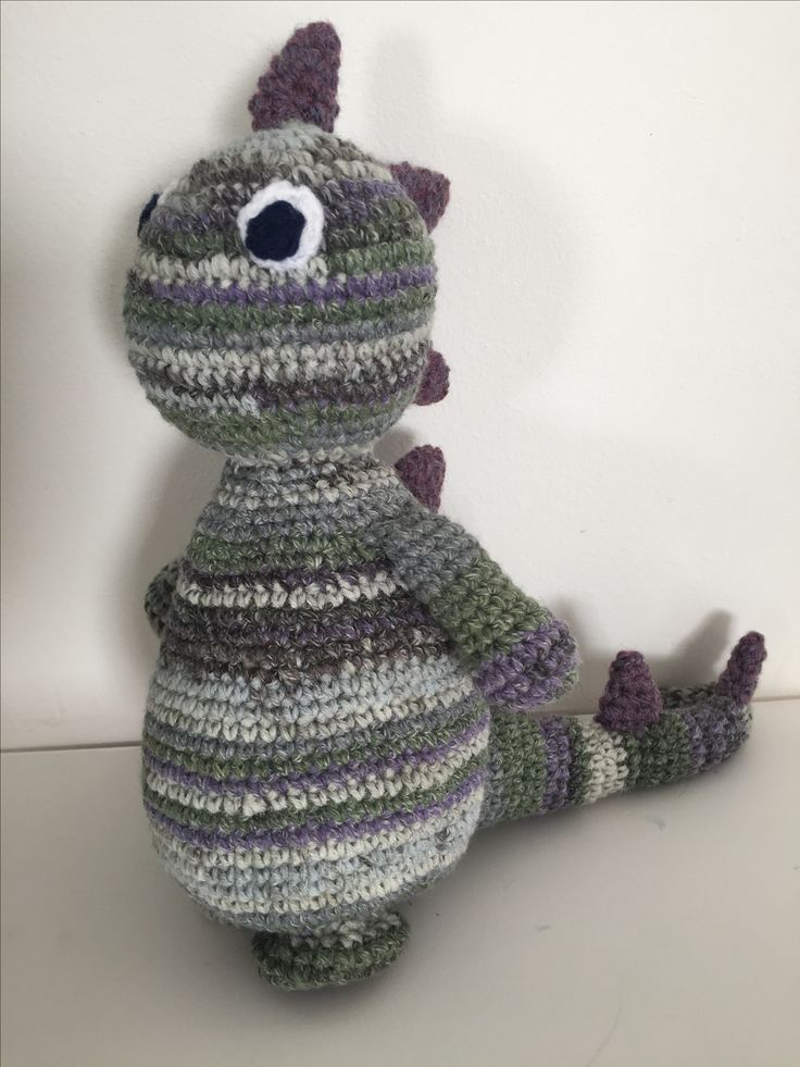 Cute crochet dinosaur made using a DMC pattern and Sirdar wool