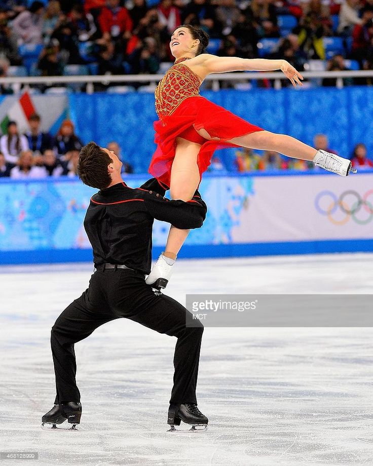 Canada's Tessa Virtue and Scott Moir perform during the team ice dance free figure skating dance short program at the Iceberg Skating Palace at the Winter Olympics in Sochi, Russia, Sunday, Feb, 9, 2014. Canada's team won the Silver medal in the event.