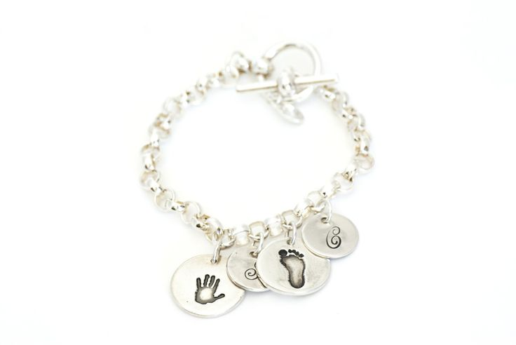 Two Handprint Charms and Initial Charms on a Toggle Charm Bracelet