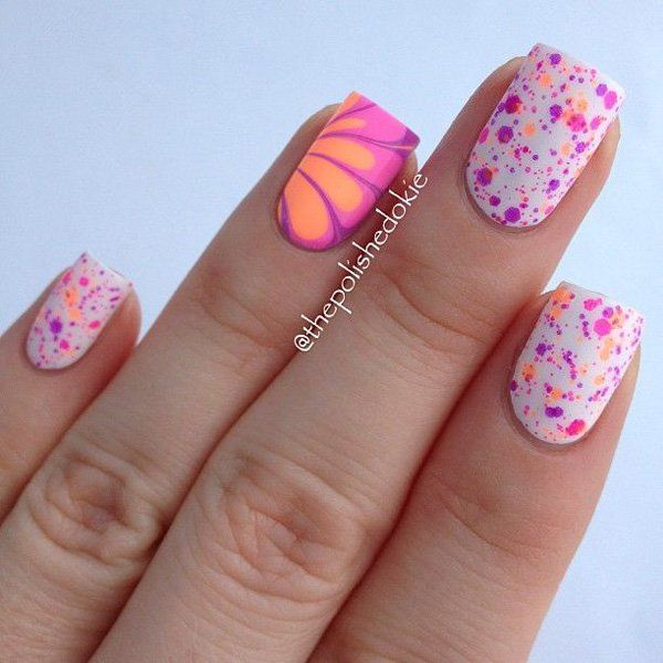 A cute water marble art design inspired nail art in white, pink yellow, orange and violet color combination.