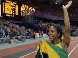 Jamaica's Shelly-Ann Fraser-Pryce celebrates winning gold in the women's 100-meter final during the athletics competition in the Olympic Stadium at the 2012 Summer Olympics, Saturday, Aug. 4, 2012, in London.(AP Photo/David J. Phillip)
