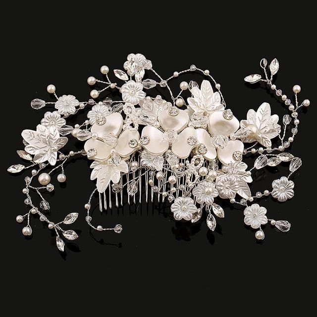 Beautiful range of bridal hair accessories , headpieces, hand embroidered veils , simple plain veils, shoe jewellery, hand embellished sashes and belts, cuffs, Capelets and  bridal cover ups           available to order @   www.QUE-VA.com    Caiomhe Keane bridal couture and tailoring services  00353879034796