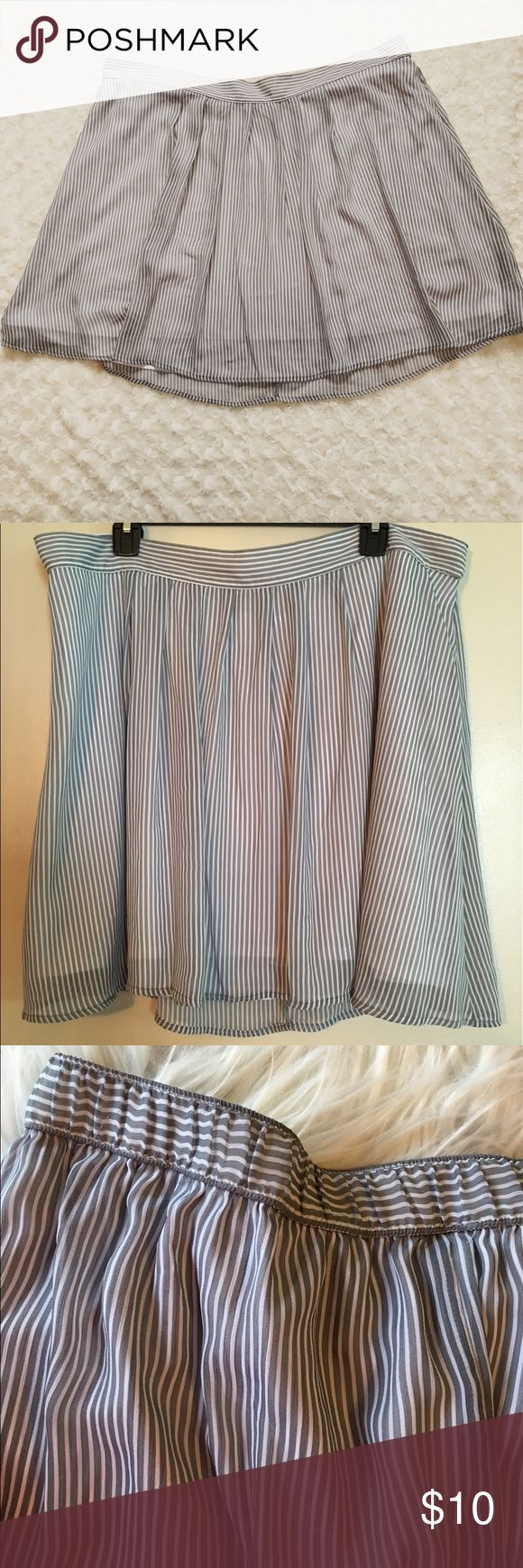 "Old Navy XL Stripe Skirt Flirty, fully lined, striped skirt from Old Navy.  There's a tiny spot on the liner that you cannot see while wearing.  Please see pictures.  In some light the stripes look grayish blue in other light they look gray.  The third picture is as close to natural light as I could capture.  The back of the waist band is elastic.  18"" long. Old Navy Skirts"
