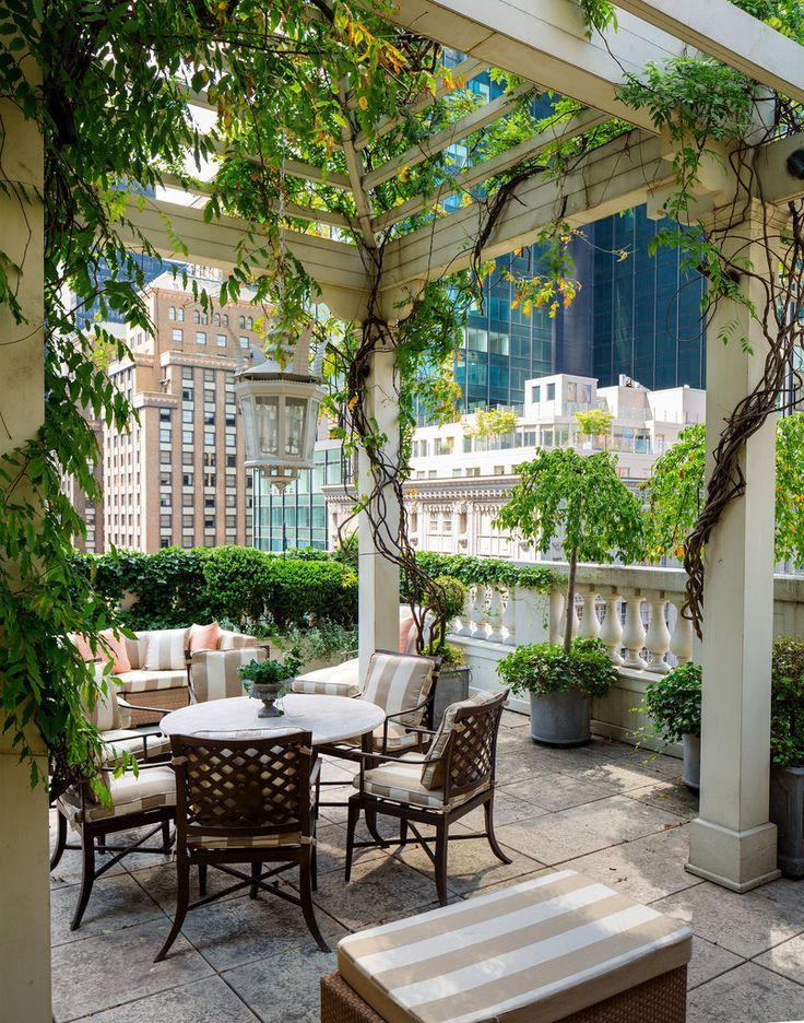 The view from the terrace, where Mario Buatta designed a pagoda and a fireplace in this urban rooftop outdoor space.