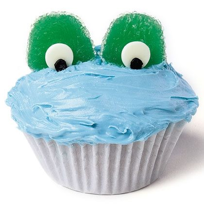 Start with a batch of cupcakes frosted a watery blue. For each one, slice a large green gumdrop in half. Press the tip of a white chocolate chip into the cut surface of each half, centering it near the bottom edge. Squirt a dab of black decorators' icing onto each chip. Then press the frog eyes into the frosting.