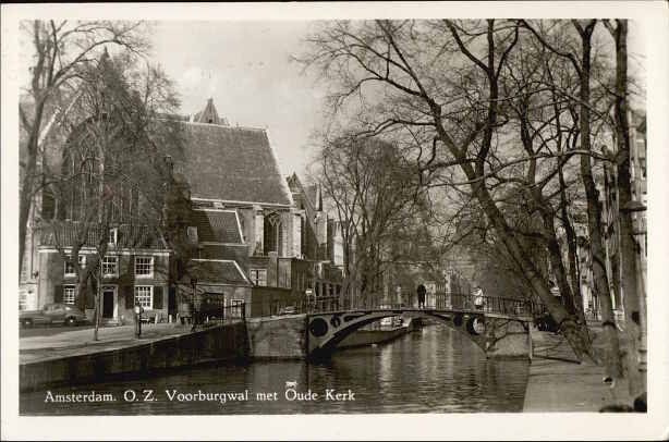1950. View on the Oudezijds Voorburgwal in Amsterdam with on the left the Oudekerk on the Oudekerksplein. The Oudezijds Voorburgwal, often abbreviated as OZ Voorburgwal, is a street and canal in the red light of Amsterdam. The OZ Voorburgwal runs from the Grimburgwal in the south to the Zeedijk in the north, where it merges with the Oudezijds Kolk. #amsterdam #1950 #OudezijdsVoorburgwal #Oudekerk