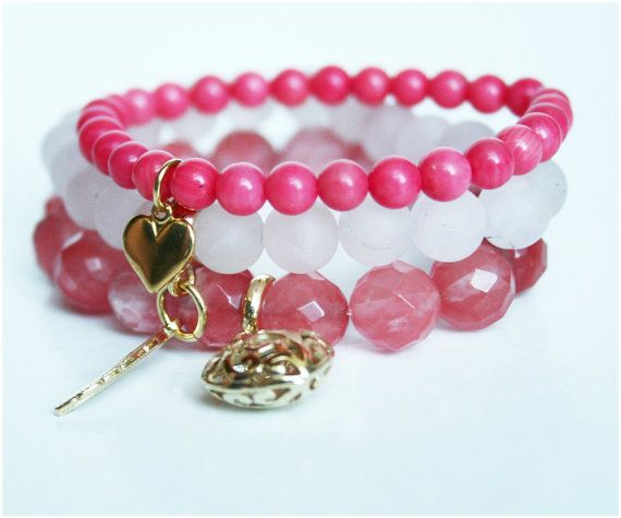 Set of three gemstone bracelets in powder, frosty, and coral pink colours