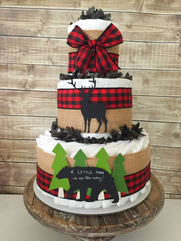 A Little Man is on his way diaper cake in buffalo check, Lumberjack Baby Shower Centerpiece by AllDiaperCakes on Etsy https://www.etsy.com/listing/505910359/a-little-man-is-on-his-way-diaper-cake