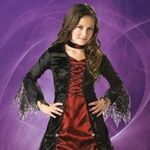 Gothic Vampira Girl's Costume:- This Gothic Vampira girls vampire costume includes a full length lace-trimmed panne and shimmer satin gown, jeweled choker and tulle / lace petticoat.
