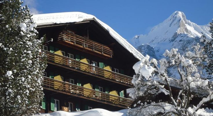 Hotel Tschuggen Grindelwald This small chalet hotel is located in the centre of Grindelwald, 350 metres from the train station and the First cable car. Wi-Fi and parking are available free of charge.