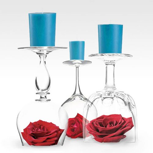 """Centerpieces. 3 different goblets, upturned on flowers, candles on """"bottom"""" and center them all on a clear or colored plate."""