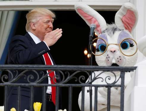 17 April 2017: US President Donald Trump salutes next to the Easter Bunny at the White House Easter ... - Joshua Roberts/Reuters