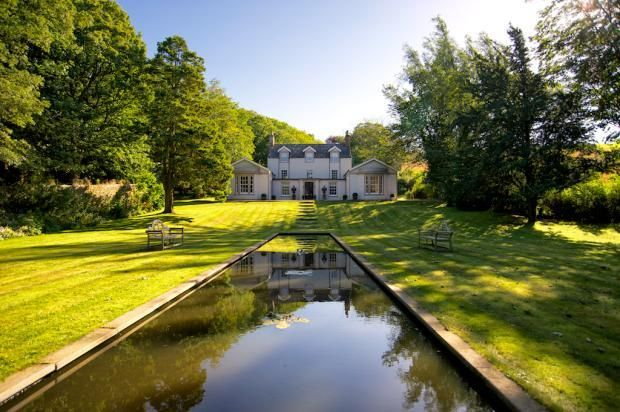 A captivating and elegant period country residence and steading in a private woodland setting