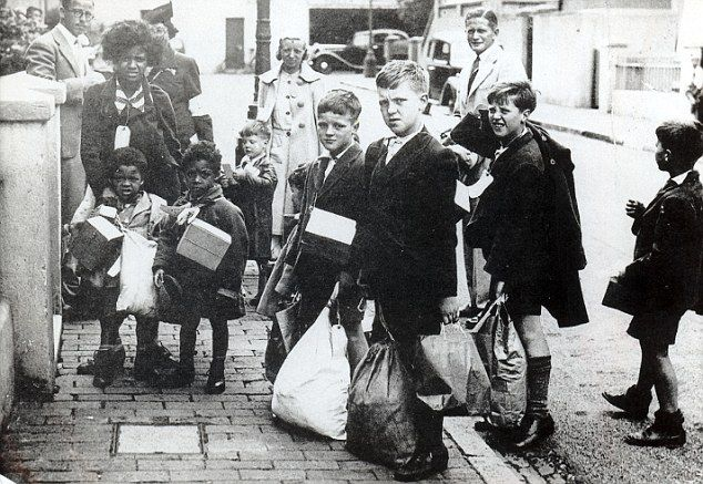 Heading out of London: Children carry their belongings in the first mass evacuation in September 1939