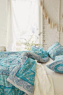 That Boho Chick: New Arrivals in Bedding, Art, Rugs, and Accessories I like the white brick wall