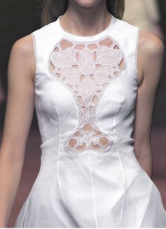 Sleeveless white dress with fabric insert & decorative cut out patterns; fashion details // Carven