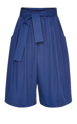 The CFDA Vogue Fashion Fund alumni deliver a languid, almost fluid collection for Resort 2016, inspired by literary muses and their 1920s boho milieu. These **Tome** pants allude to of-the-moment inspirations in blue cotton sateen and a cropped karate silhouette.