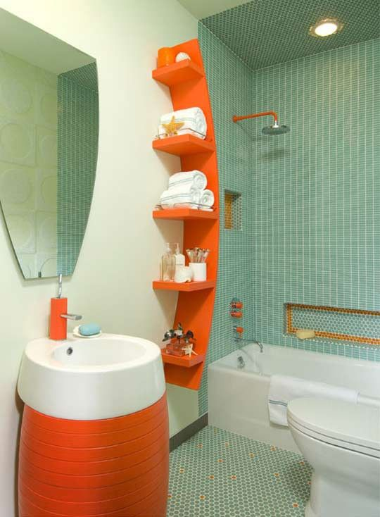 Great use of orange as an accent colour. I love this shelving unit