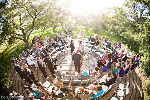 Wedding in the round...guests surrounding instead of behind!  Love the placement of the wedding party.