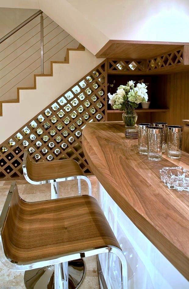 WINNING WINE CELLARS: elegant home #bar with a built-in #wine display rack under the #staircase