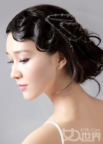 Finger waved fringe with a contemporary soft, loose bun