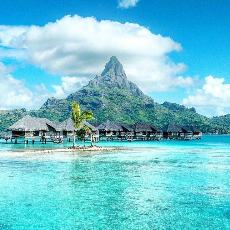 Bora Bora, French Polynesia. Bora Bora is a small South Pacific island northwest of Tahiti. Surrounded by sand-fringed motus and a turquoise lagoon protected by a coral reef, it's known for its scuba diving.