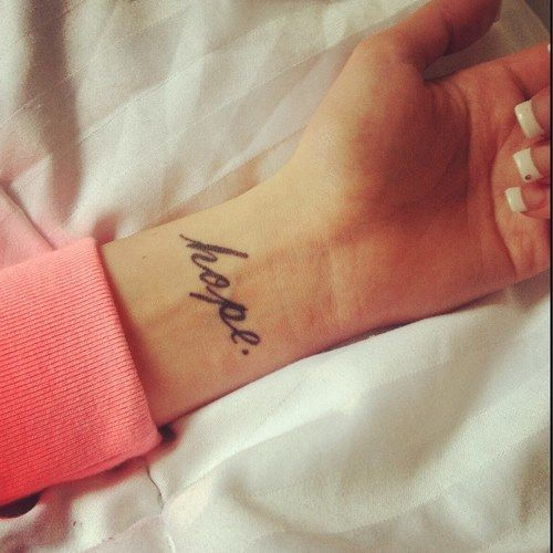This picture is an example of yellow because yellow has an effect of hopeful; which is shown by the tattoo.