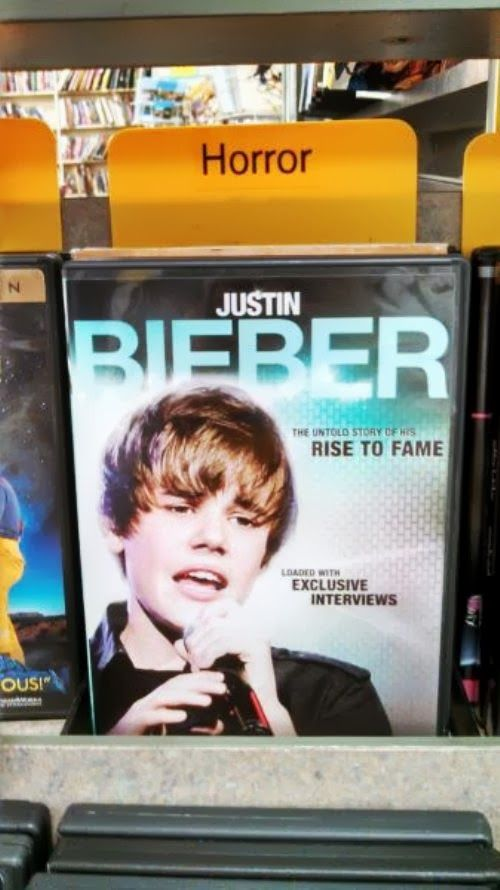 Music Humor | Justin Bieber in the horror section at the CD Store | From Funny Technology - Google+ posted by Christoph S