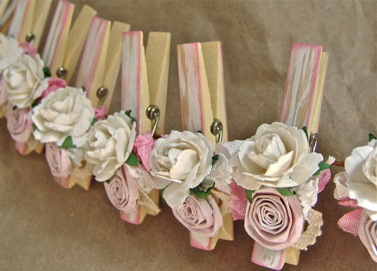 Shabby Chic Nursery PINK decorated Clothes Pins Decorated Clothes Pegs Set of 10 with handmade flowers PINK paper flower. $22.50, via Etsy.