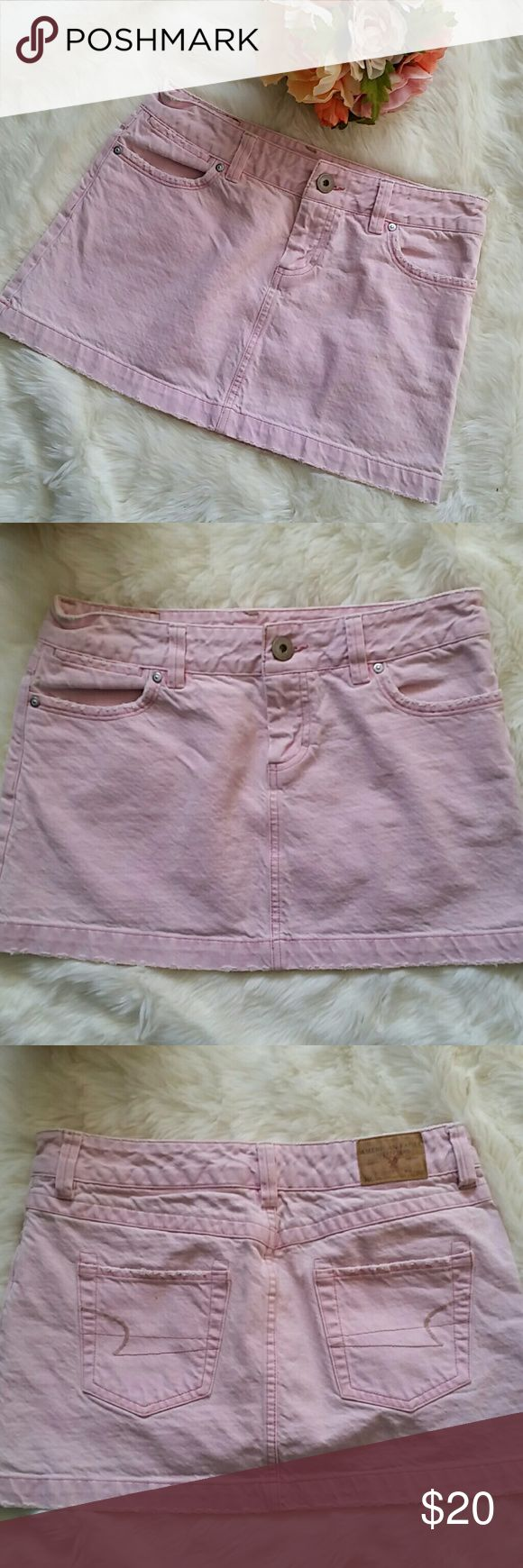 🕓 FINAL PRICE! Blush denim mini skirt Adorable blush mini skirt from American Eagle.  Destroyed look.  Small mark of left back pocket,  pictured and otherwise excellent condition.  Measures 11.5 inches long. American Eagle Outfitters Skirts Mini