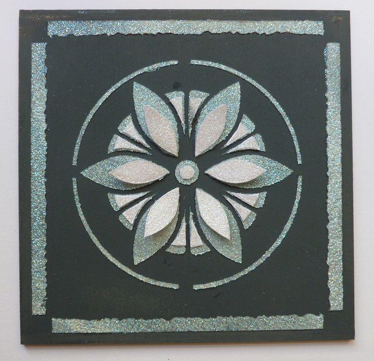 'Flower Petals MDF plaque.   Imagination Craft's -  MDF' House' Charm kit.      Diamond Sparkle Medium.   Black MDF paint. ' Tile Petal'  stencil    Metal spatula.  Paint brush.  Home Bake-' open petal' stencil.      May 2014,
