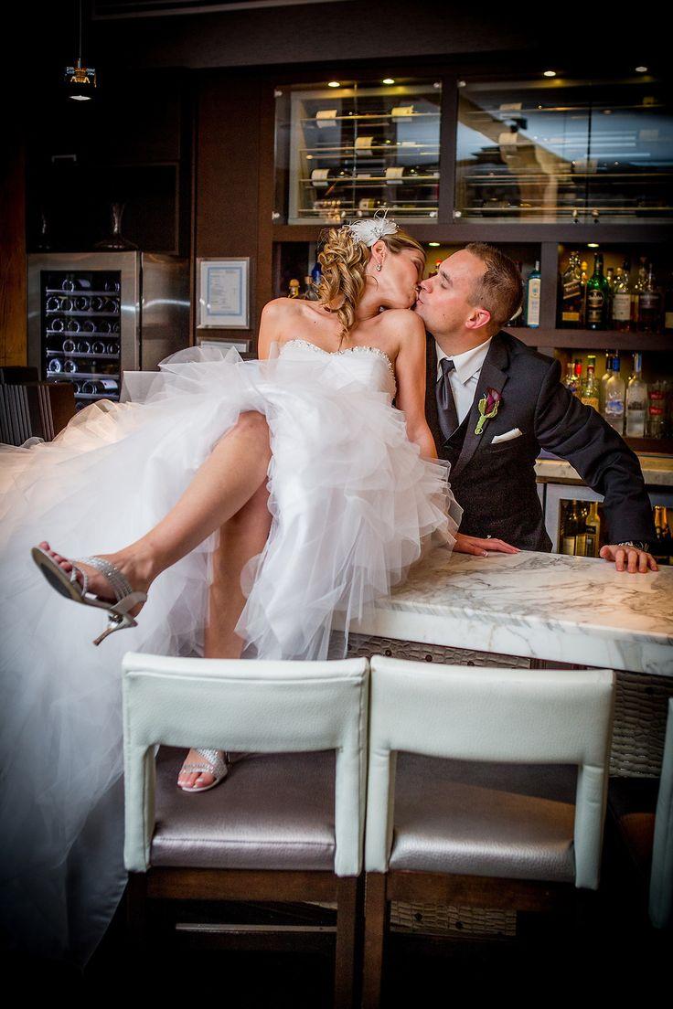 Bride and Groom, Tulle dress, Curly wedding hair, Bar, Wedding Venue, Cambridge Mill, Cambridge, Ontario, Canada wedding photography experts | Anne Edgar Photography