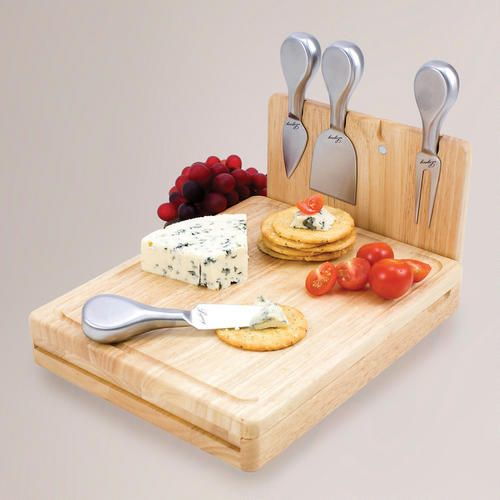 One of my favorite discoveries at WorldMarket.com: Folding Cheese Board Tool Set