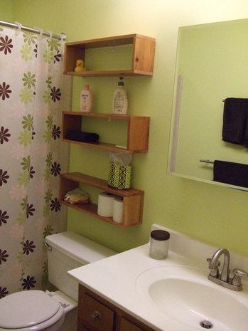 Bathroom remodeling is done » Curbly | DIY Design Community Great storage idea without blocking access to toilet tank or looking too bulky for small bathroom