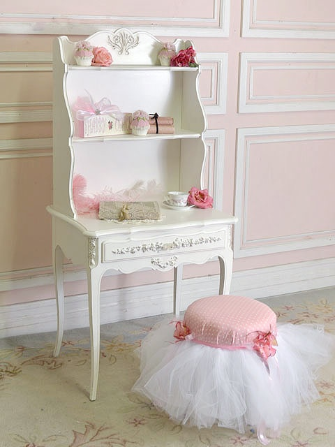 Shabby Chic Hutch. I'm not sure I like this, but I like the concept of the tulle fluffed out around the chair.