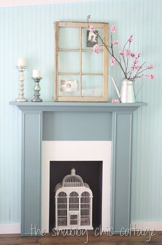 DIY Faux Fireplace... need to do something with mine... like the decor on this one.