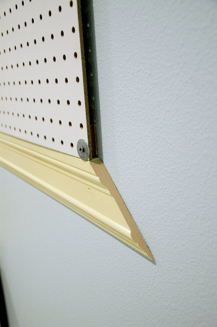 DIY:  How to Hang Pegboard - how to hang it away from the wall so you can add the hangers + how to frame it with moulding so it looks finished - via Little Nanny Goat