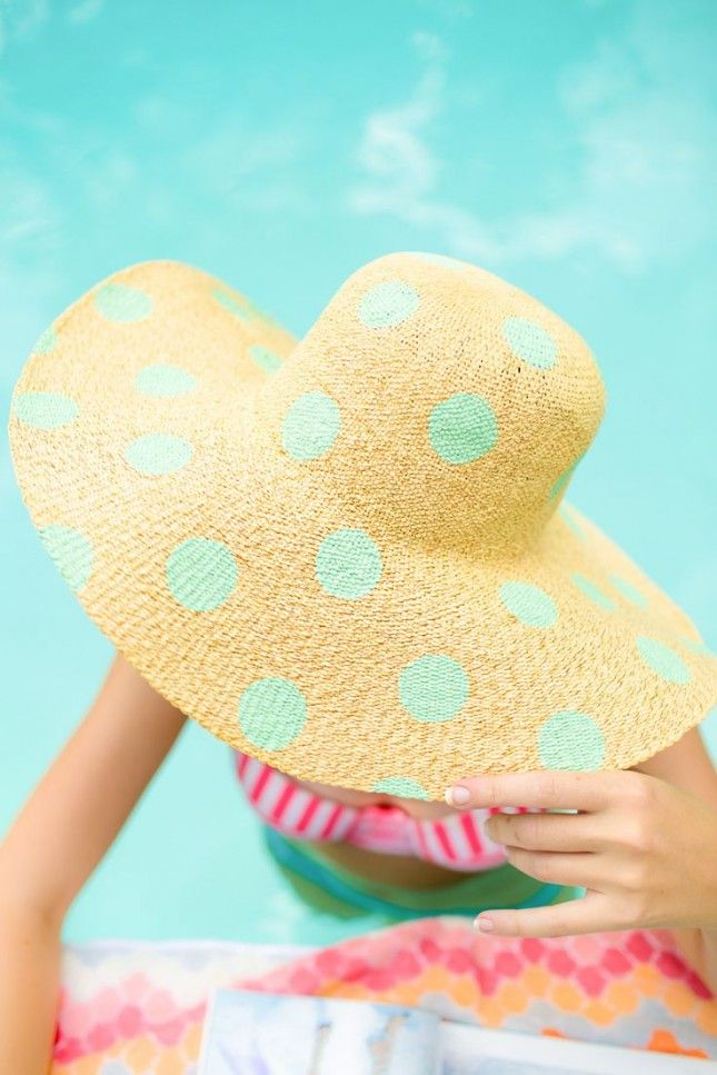 Use some paint to decorate a plain floppy hat for trendy summer style