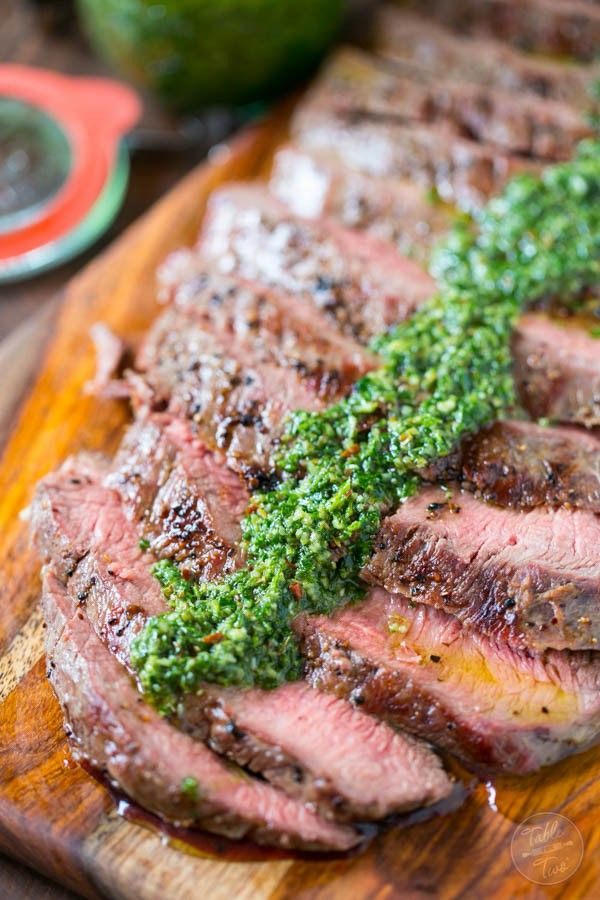 Grilled flank steak with homemade chimichurri sauce is the perfect summertime recipe! Dust off those grills and get your steak on!